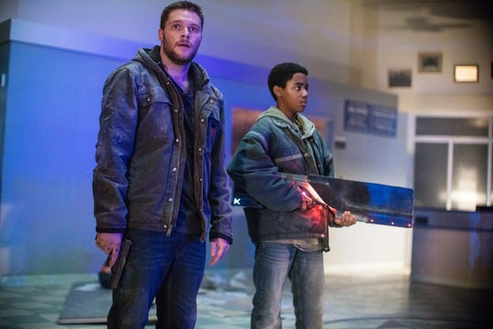 "Jack Reynor (left) and Myles Truitt play brothers in the thriller ""Kin."""