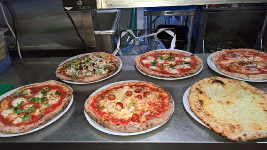 Vasyl Lemberskyy makes pizzas of all kinds at Santino's Little Italy in Bay View.