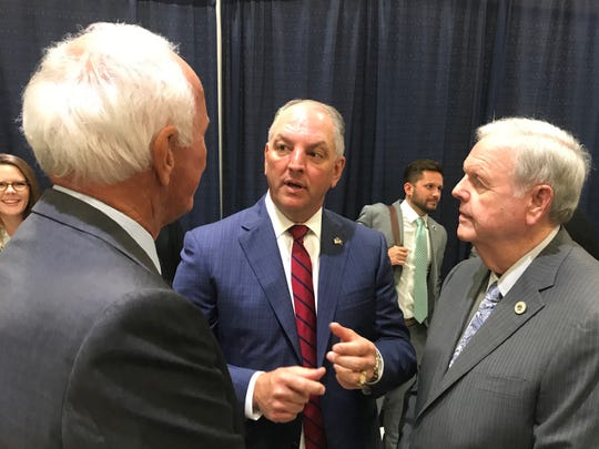 Gov. John Bel Edwards, center, speaks to LSU Health Sciences Center Vice Chancellor Les Johnson, right, and state Rep. Bubba Chaney, R-Rayville, after his State of the State address in Tuesday in Monroe.