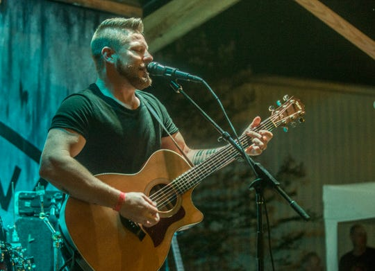 Justin Rivers performs after being named the local NASH Next winner. Montgomery's local finals NASH Next 2018 were held Friday, Aug. 24, 2018, at Range 231 N.