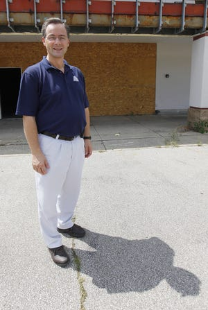 Roy Padgett, CEO of Small Engine Warehouse, is shown in this photo from 2014 outside the former southside Kmart, which Small Engine Warehouse purchased for a warehouse.