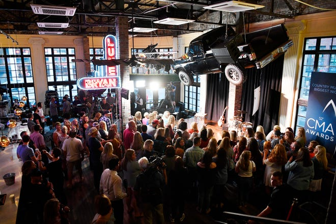 The crowd awaits the start oft the 2018 CMA nominations announcement event Tuesday, Aug. 28, 2018, at Luke's 32 Bridge Food and Drink in downtown Nashville, Tenn.