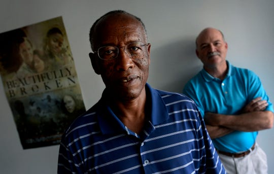 Randy Hartley, right spent years working with William Mwizerwa to help Mwizerwa bring his family to the U.S. from Rwanda after the genocide.