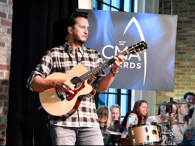 Luke Bryan rehearses before the start of the 2018 CMA nominations announcement event Tuesday, Aug. 28, 2018, at Luke's 32 Bridge Food and Drink in downtown Nashville, Tenn.