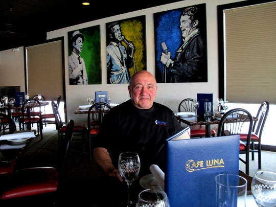 Ed Barsamian, the longtime co-owner of Cafe Luna, poses for a portrait in 2016 at the restaurant's location at Liberty Plaza in Naples.