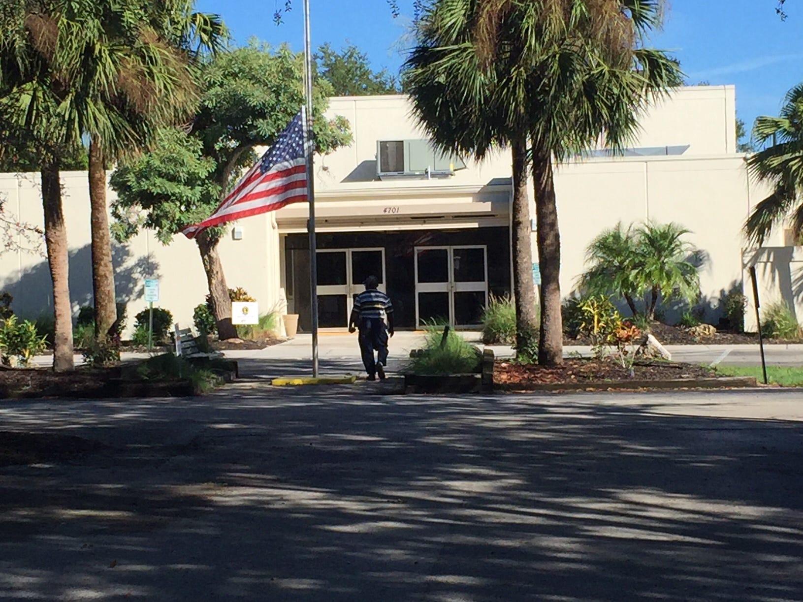 A person walks toward the  Golden Gate Community Center, precinct 323, on Aug. 28, 2018.