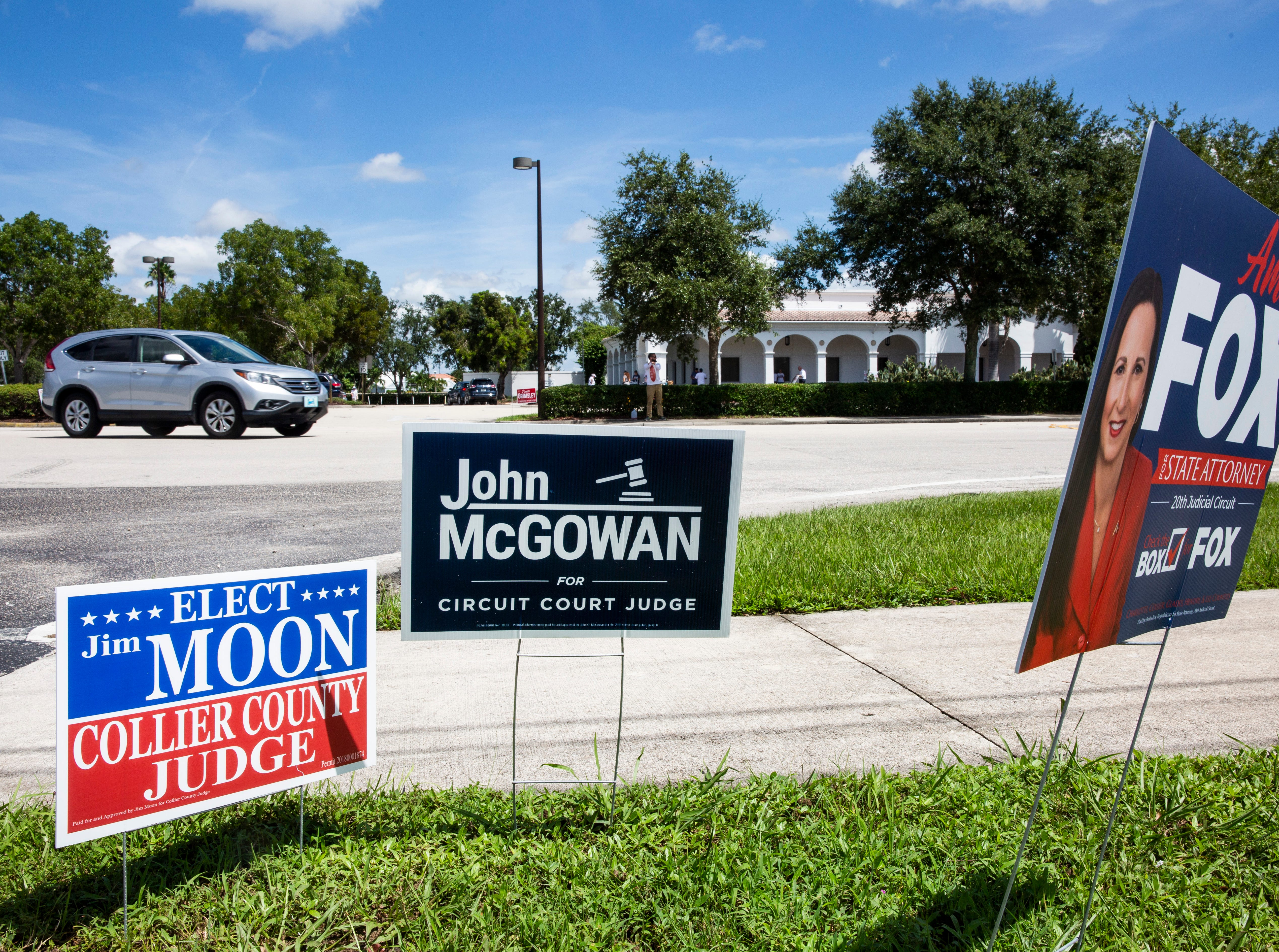 Campaign signs line the sidewalk across the street from the Collier County Public Library Headquarters in North Naples on Tuesday, August 28, 2018.