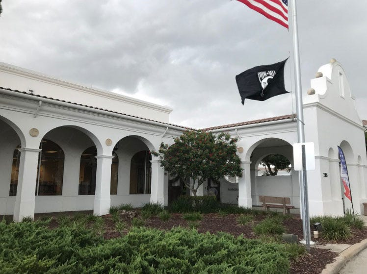 It begins to rain at the library headquarters on Orange Blossom Drive on Aug. 28, 2018.