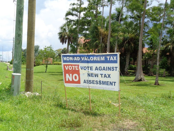 A sign opposing the proposed fire fee in the North Naples fire district.