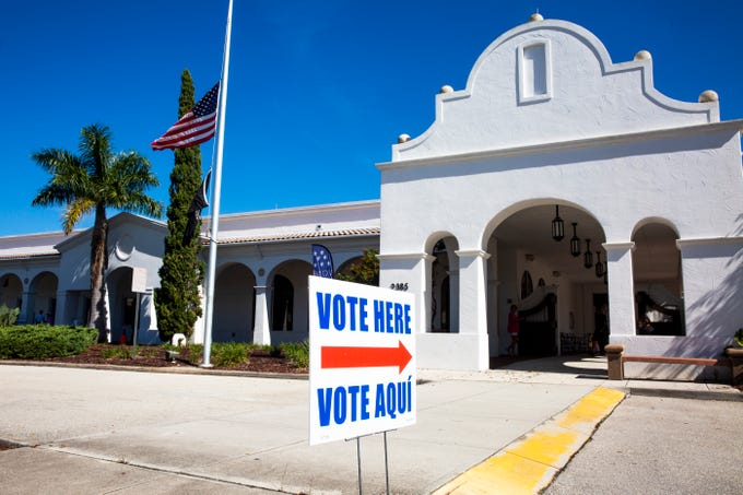 A sign points voters in the right direction at the Collier County Public Library Headquarters in North Naples on Tuesday, August 28, 2018.
