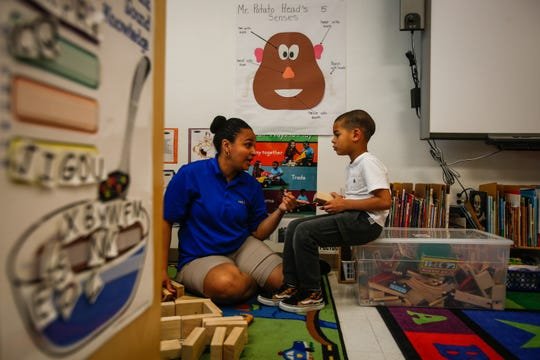 Linessa Barnhart, an assistant teacher at the Guadalupe Center, plays with Ryann Rijo, 5, May 29, 2018 in Immokalee, Fla.