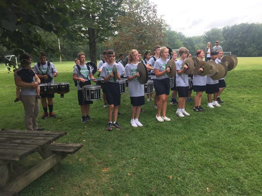 Drummers from Granville High School perform following the Aug. 25 ribbon-cutting at Wildwood Playground.