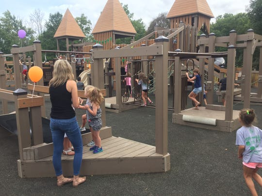 Children enjoy the newly renovated Wildwood Playground at its official dedication ceremony on Aug. 25.