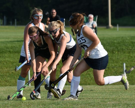 Dublin Jerome's Jane Goodstein (center) gets caught between Granville defenders Danielle Miller, Cate Banks, and Ava Banks during a match on Monday, Aug. 27, 2018. The Blue Aces lost 2-1 at home.