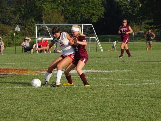 Licking Heights senior Lauren Beaver battles a Bishop Rosecrans player for possession during an Aug. 27 match.