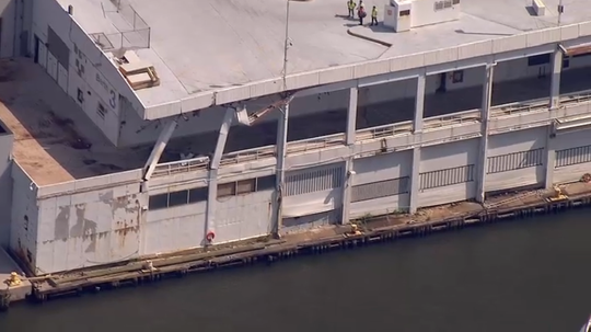A cruise ship smashed into a west side Manhattan dock early Tuesday morning, leaving damage but no injuries, according to reports.