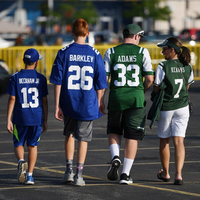Giants vs. Jets preseason game at MetLife Stadium in East Rutherford on Friday, August 24, 2018. Giants and Jets fans in the parking lot before the start of the game. (Michael Karas/@michaelkarasphoto)