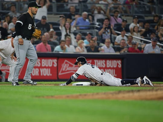 Yankees second baseman Ronald Torreyes (74) slides into third base with a triple against the Chicago White Sox during the third inning at Yankee Stadium.