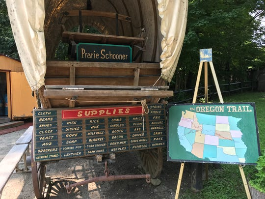 A covered wagon sits near the entrance of Wild West City, a western-themed seasonal park in Byram, N.J., on Aug. 15, 2018. The wagon is used to tell the tale of the Oregon Trail.