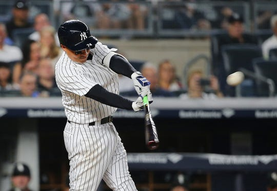Yankees second baseman Ronald Torreyes (74) triples against the Chicago White Sox during the third inning at Yankee Stadium.