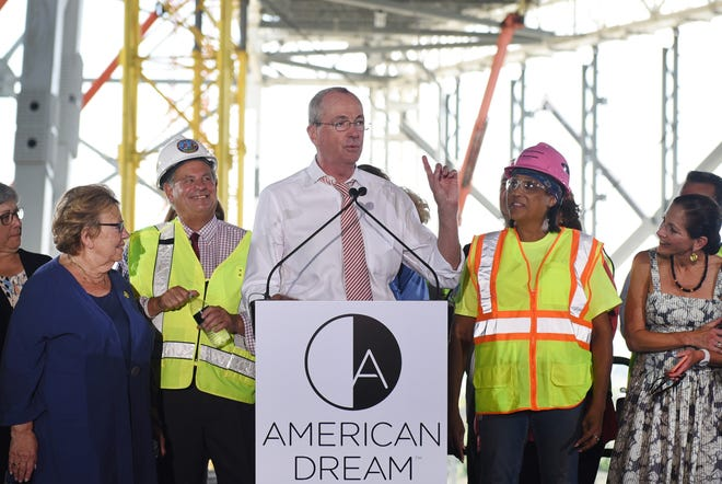 Governor Phil Murphy speaks as other state and local leaders, listen during a press conference to express their appreciation to the men and women of the building construction trades and the Bergen County Building & Construction Trades Council at the construction site of the American Dream project in East Rutherford on 08/28/18.