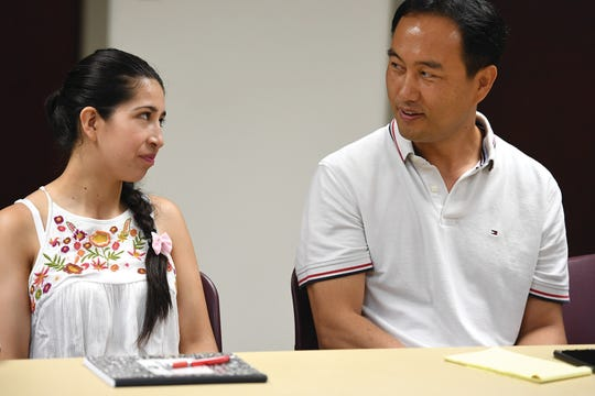 (right) Dave Seol talks with Yaireth Cistancho during an ESL class on Tuesday, July 24, 2018.