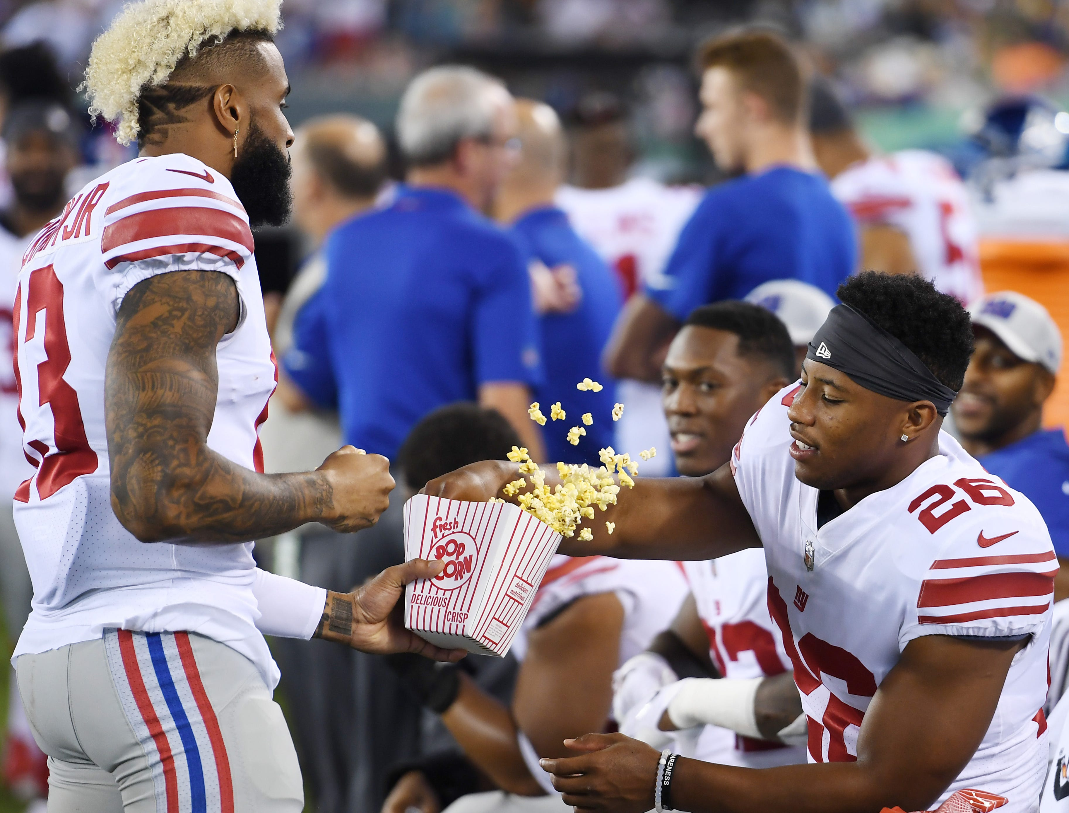 Giants vs. Jets preseason game at MetLife Stadium in East Rutherford on Friday, August 24, 2018. G #13 Odell Beckham Jr. and #26 Saquon Barkley eat popcorn in the fourth quarter. (Michael Karas/@michaelkarasphoto)