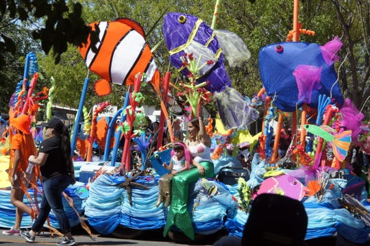 """""""Racing the Tide - Under the Sea"""" was the thee for this year's Great American Duck Race."""