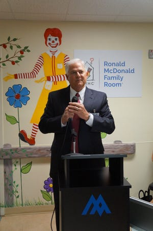 John Harris, Memorial Medical Center CEO, celebrates the opening of the region's first Ronald McDonald Family Room in 2016. The room is located on the fifth floor at MMC.