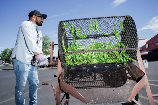 Alex Enriquez, produce department coordinator,  roasts green chile outside of Mountain View Market and Co-op on Saturday, Aug. 25, 2018.