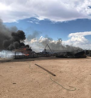 Fire crews from the Malaga Volunteer Fire Department to respond to tank battery fire Monday afternoon Aug. 27. (Travis Olbert photo)