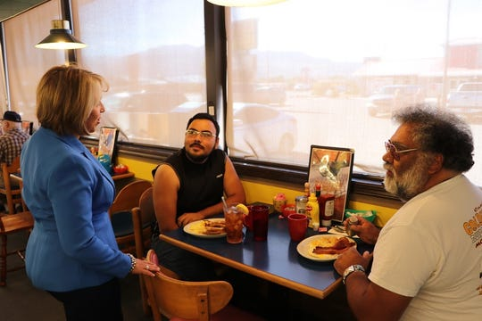 Democrat governor's candidate and Congresswoman Michelle Lujan Grisham talks to customers at the Waffle House in Alamogordo while on the campaign trail Tuesday.