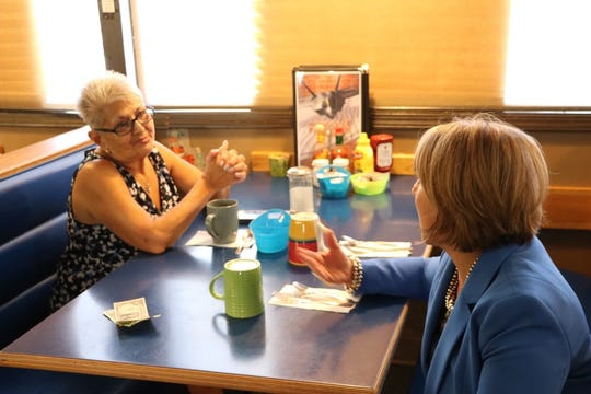 Democratic governors candidate Michelle Lujan Grisham talks with a customer at the Waffle House in Alamogordo Tuesday.