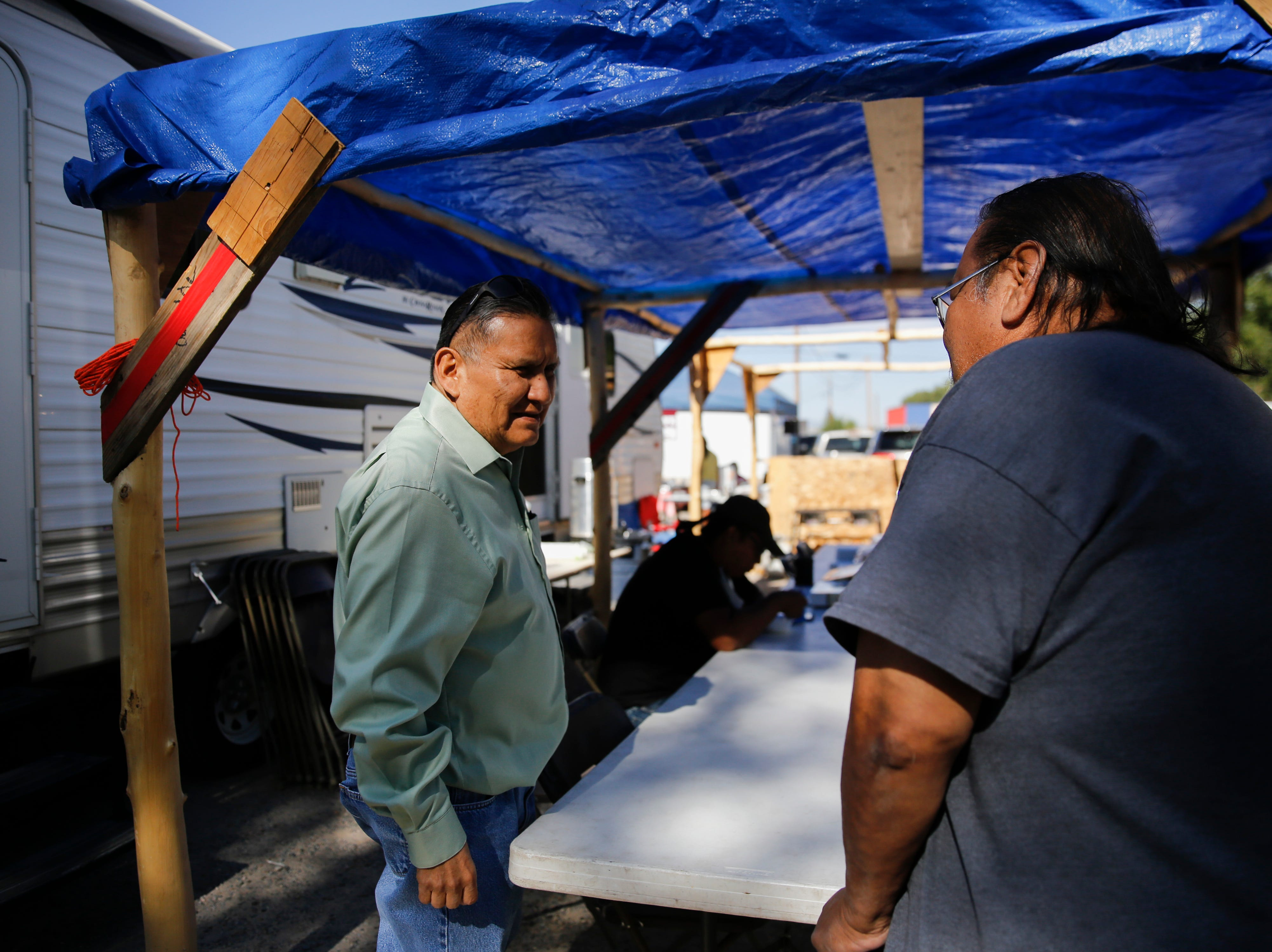 Dan Smith, left, a Navajo Nation Council Delegate candidate for Shiprock talks with voters, Tuesday, Aug. 28, 2018 at the Shiprock Chapter House.