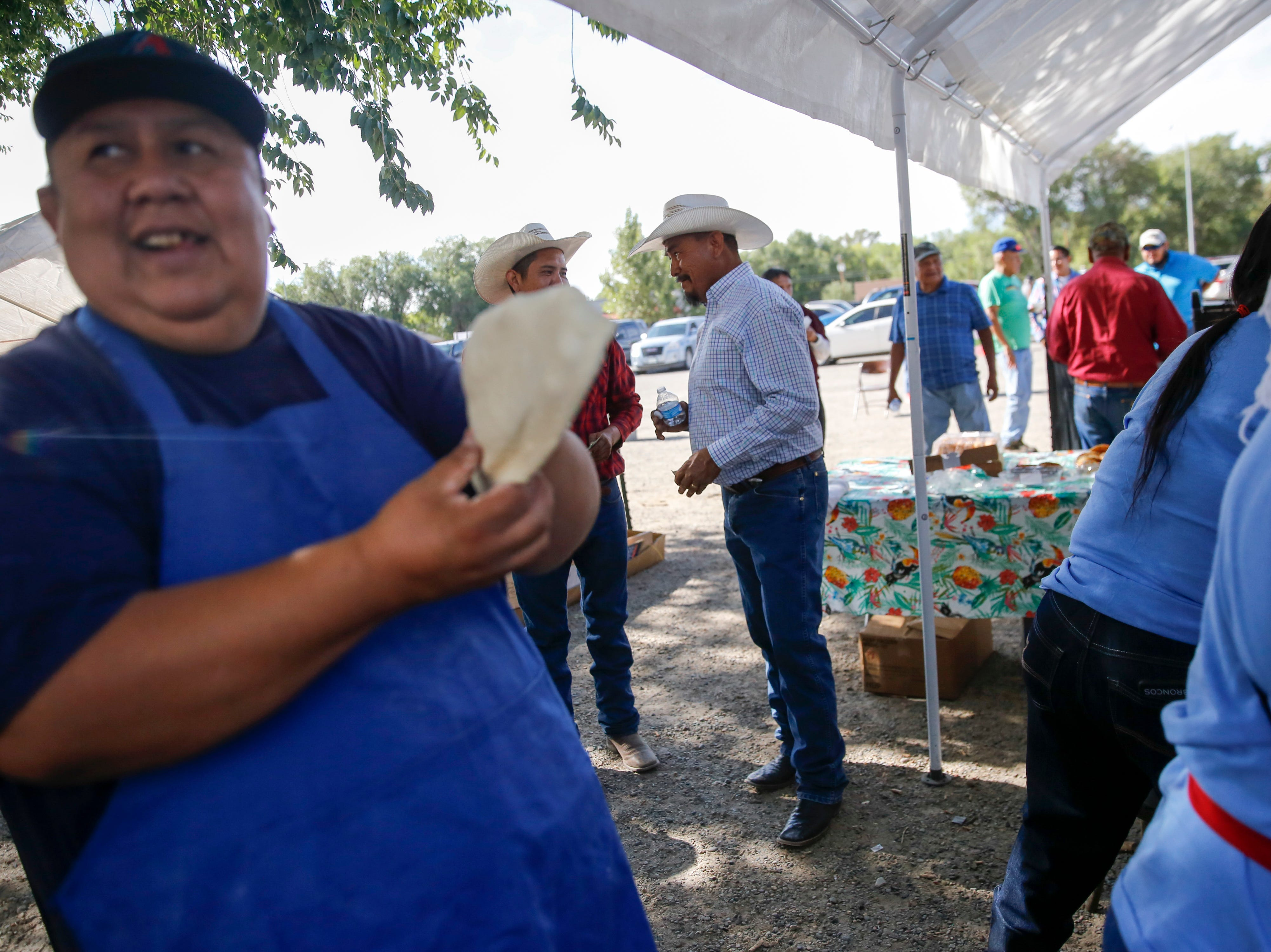Navajo Nation Presidential candidate Tom Chee, center, talks with voters, Tuesday, Aug. 28, 2018 at the Shiprock Chapter House.