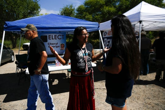 Shiprock Council Delegate candidate Cheryl George, center, talks with voters, Tuesday, Aug. 28, 2018 at the Shiprock Chapter House.