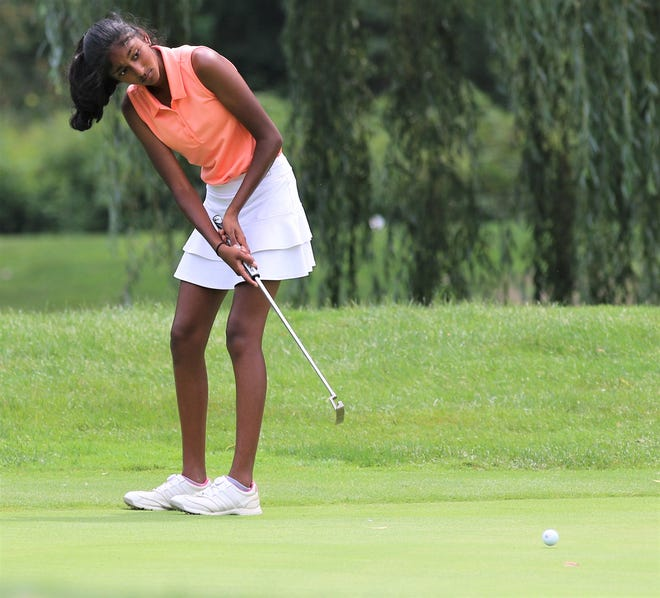Northville's Megha Vallabhaneni makes the putt attempt in the Coach Miller Invitational held at Oak Pointe Country Club in Brighton.