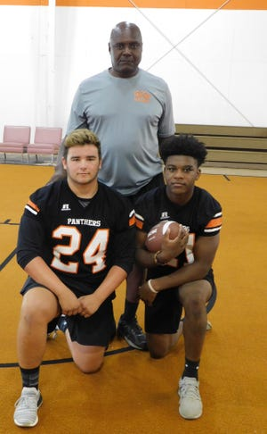 """Pine Prairie High head coach Yves Prince is pictured with two of his standout senior football players, Joel Franks (24)  and JJ Sims (21). Sims said Prince always reminisces about playing at Grambling. """"Coach Prince is one of a kind,"""" said Franks."""