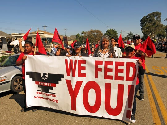 Teresa Romero, second from right, marches with United Farm Worker supporters.