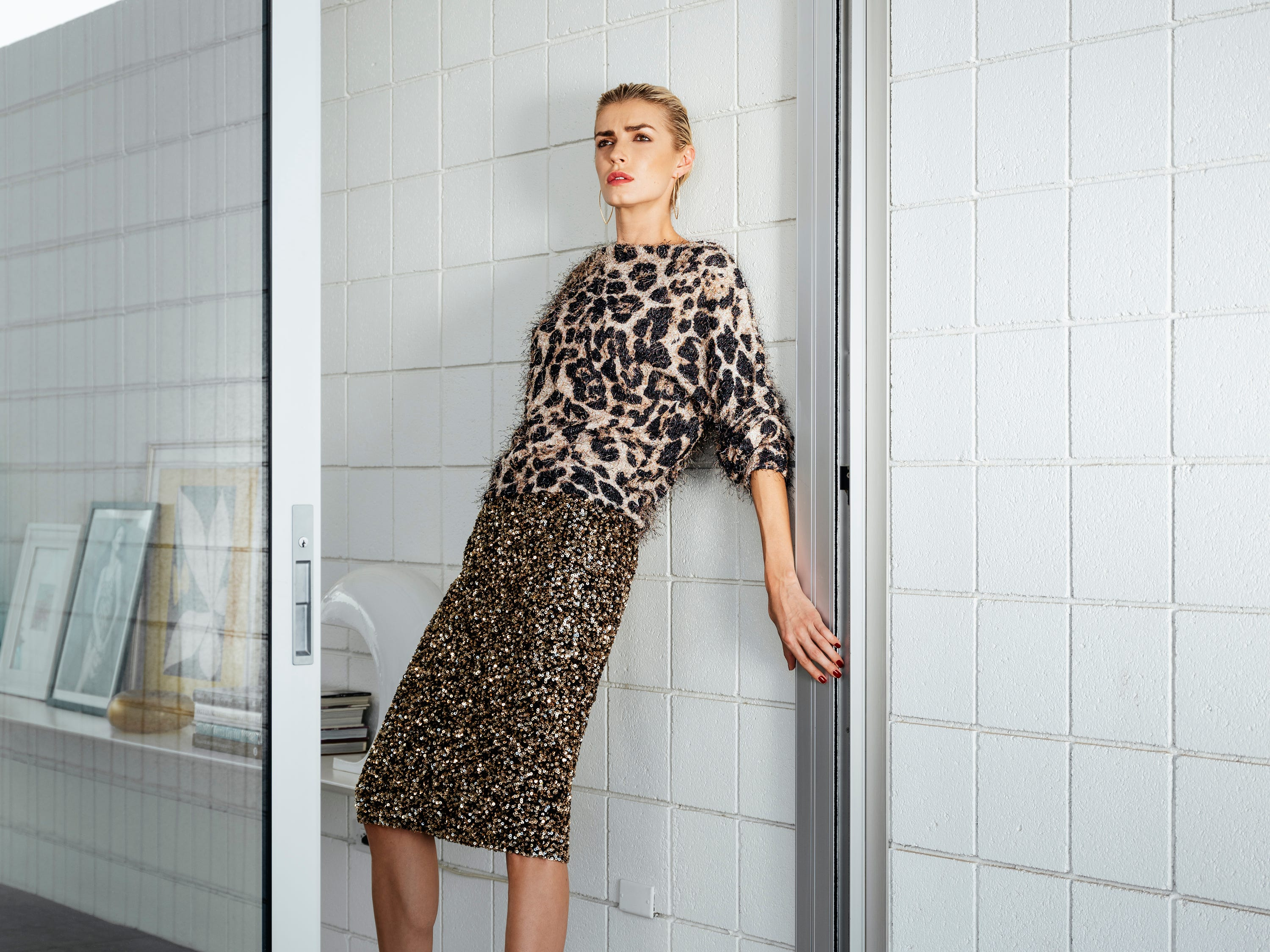Loyd/Ford leopard sweater and  sequin skirt, at loydford.com.  Gucci stilettos and pink socks, stylist's own. BB.one earrings, at bboneapparel.com. (Styling by Neil Cohen; hair and makeup by Chelsea Dorris; model: Milena Ilina; creative direction: Kristin Scharkey; location: Desert One, Palm Springs)