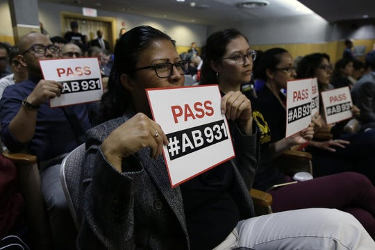 Rosa Cabrera, foreground, joined others in support of a measure to limit police use of deadly force, during a hearing of the Senate Public Safety Committee, Tuesday, June 19, 2018, in Sacramento, Calif. The committee approved the bill by Assemblywoman Shirley Weber, D-San Diego, and sent it to another committee.(AP Photo/Rich Pedroncelli)
