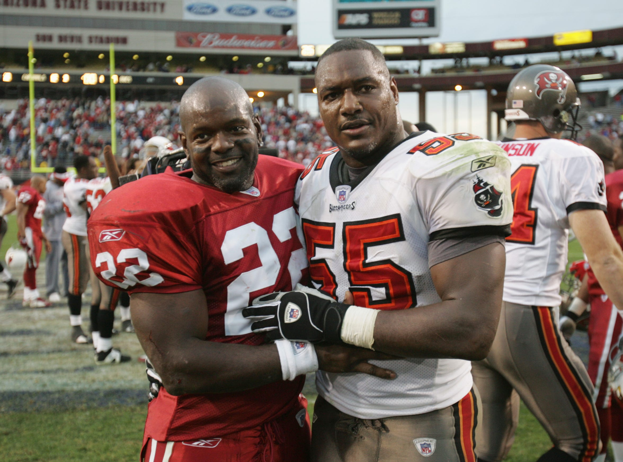 TEMPE, AZ - JANUARY 2:  Running back Emmitt Smith #22 of the Arizona Cardinals poses for a picture with linebacker Derrick Brooks #55 of the Tampa Bay Buccaneers during the game at Sun Devil Stadium on January 2, 2005 in Tempe, Arizona. The Cardinals defeated the Buccaneers 12-7. (Photo by Jeff Gross/Getty Images)