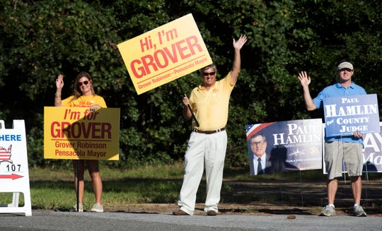 Grover Robinson, a candidate for mayor, joins others campaigning for last-minute votes outside precinct 107 Tuesday, Aug. 28, 2018.