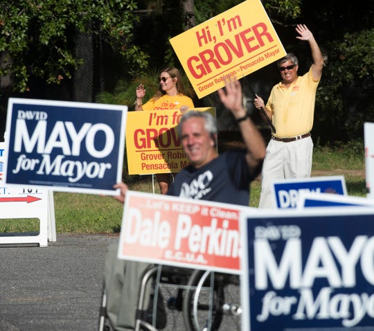 Pensacola Mayorial candidates David Mayo and Grover Robinson campaign for last-minute votes outside precinct 107 Tuesday, Aug. 28, 2018.