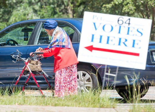 """92-year-old Violet Glover gets into her car after voting at the 64th Precinct's Cokesbury United Methodist church location on 9th Avenue in Pensacola on Tuesday, August 28, 2018.  Glover says that """"Voting is a privilege and I have never failed to vote."""""""