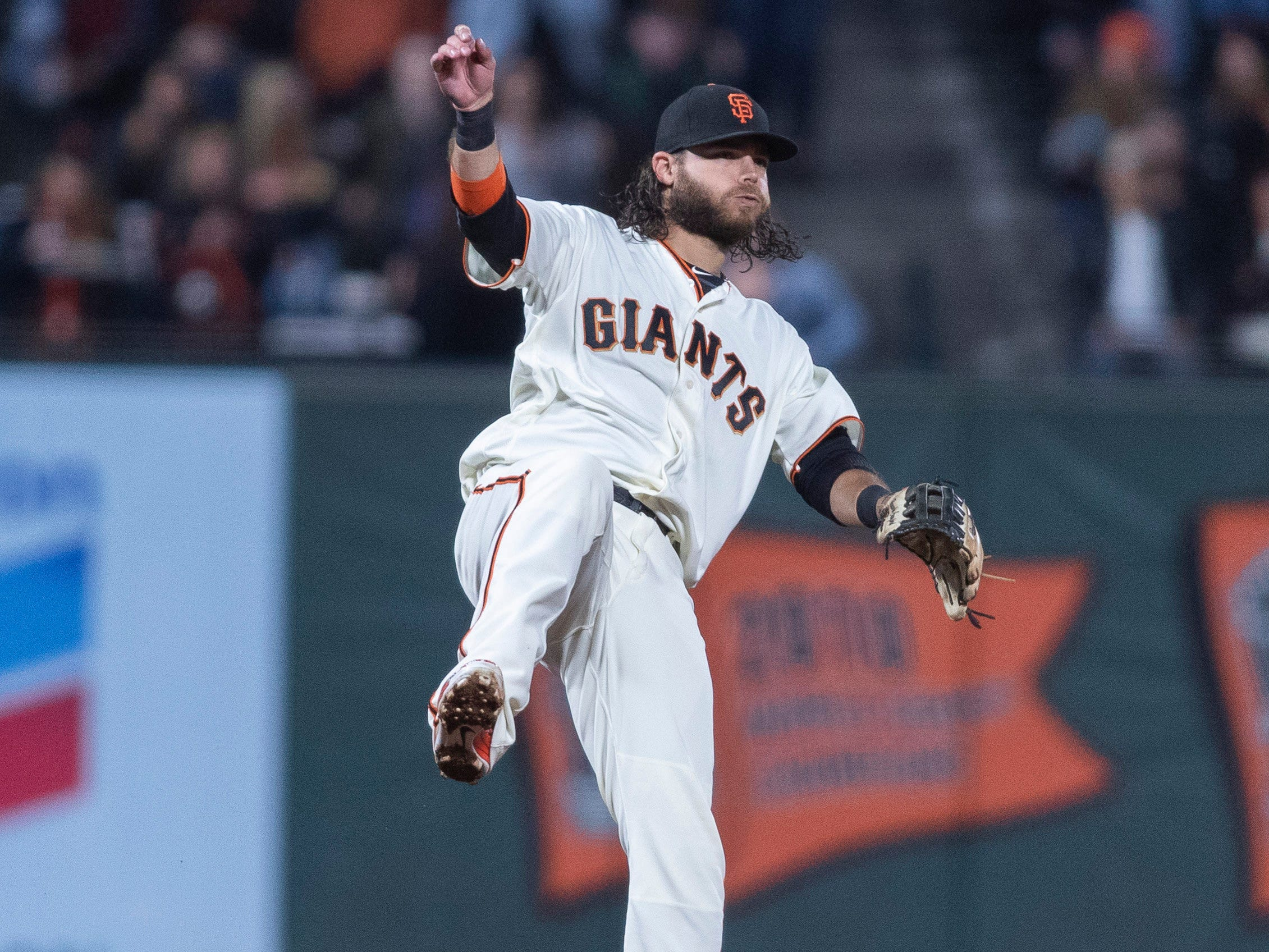 Aug 27, 2018; San Francisco, CA, USA; San Francisco Giants shortstop Brandon Crawford (35) throws out Arizona Diamondbacks right fielder Steven Souza Jr. (not pictured) during the fourth inning at AT&T Park. Mandatory Credit: Neville E. Guard-USA TODAY Sports