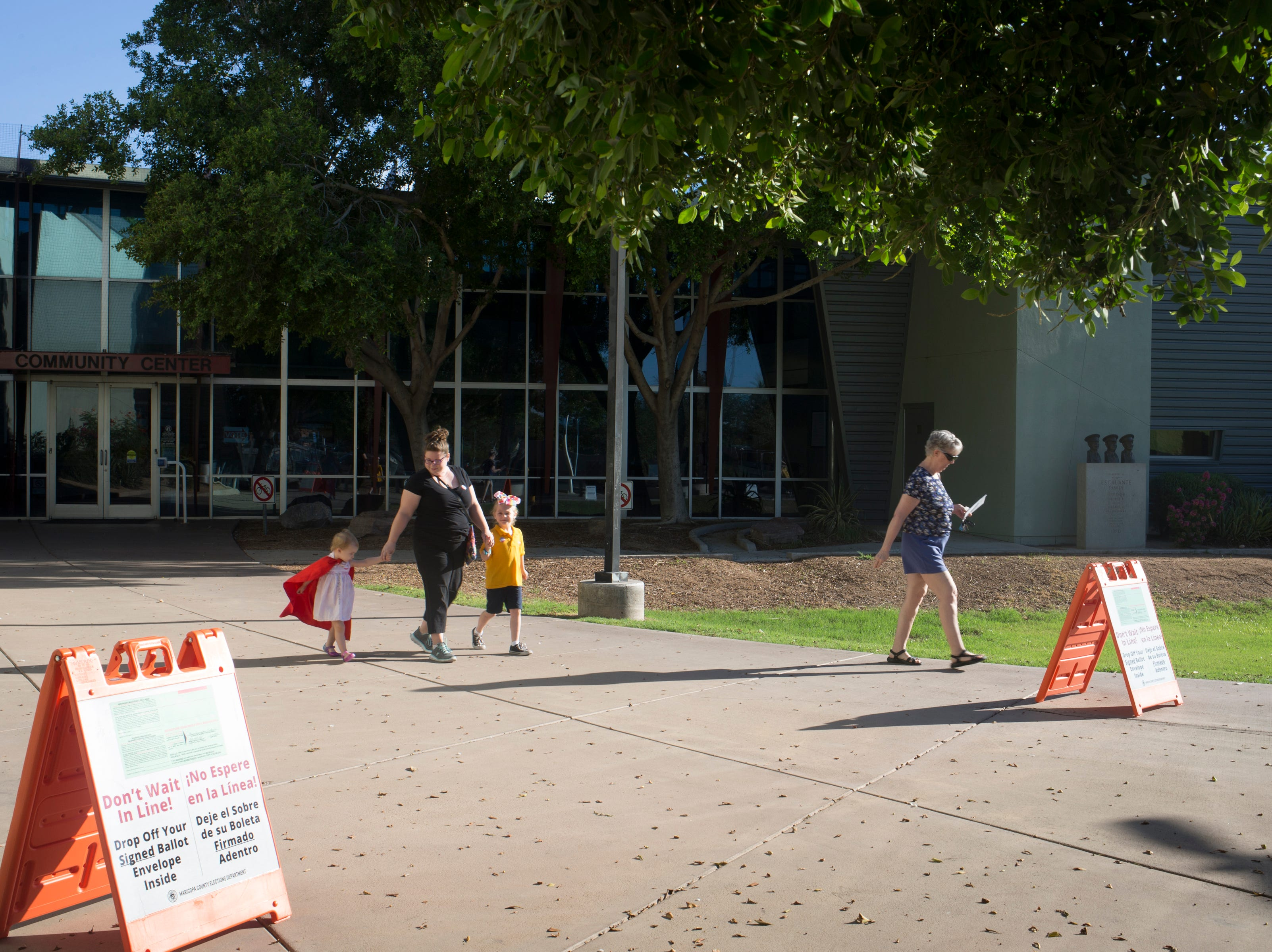 Voters leave at the polling place after voting, Aug. 28, 2018, at the Escalante Community Center, 2150 E. Orange Street in Tempe.