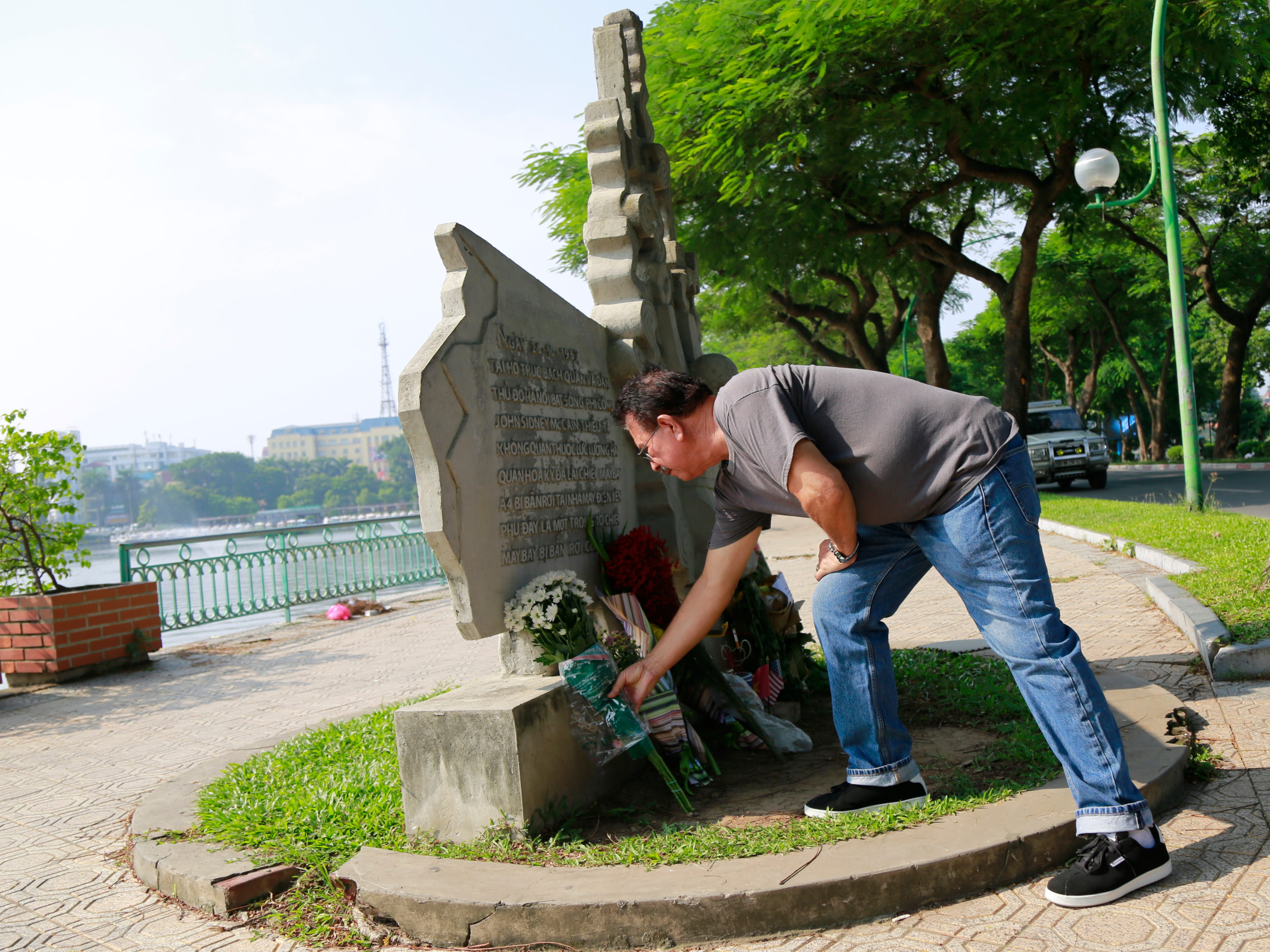 Victor Ramos, a Mexican man who has been living California for the past 35 years, lays flowers at the monument of U.S. Senator John McCain in Hanoi, Vietnam, Aug. 27, 2018. The monument was erected by the Vietnamese authorities to mark the day when then-U.S. Navy pilot McCain was shot down in 1967.