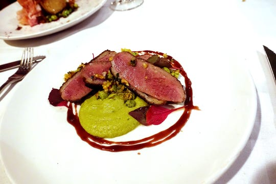 Smoked duck with green garbanzo hummus, amarena cherry agrodolce and marcona crumble at Virtù Honest Craft in Scottsdale.