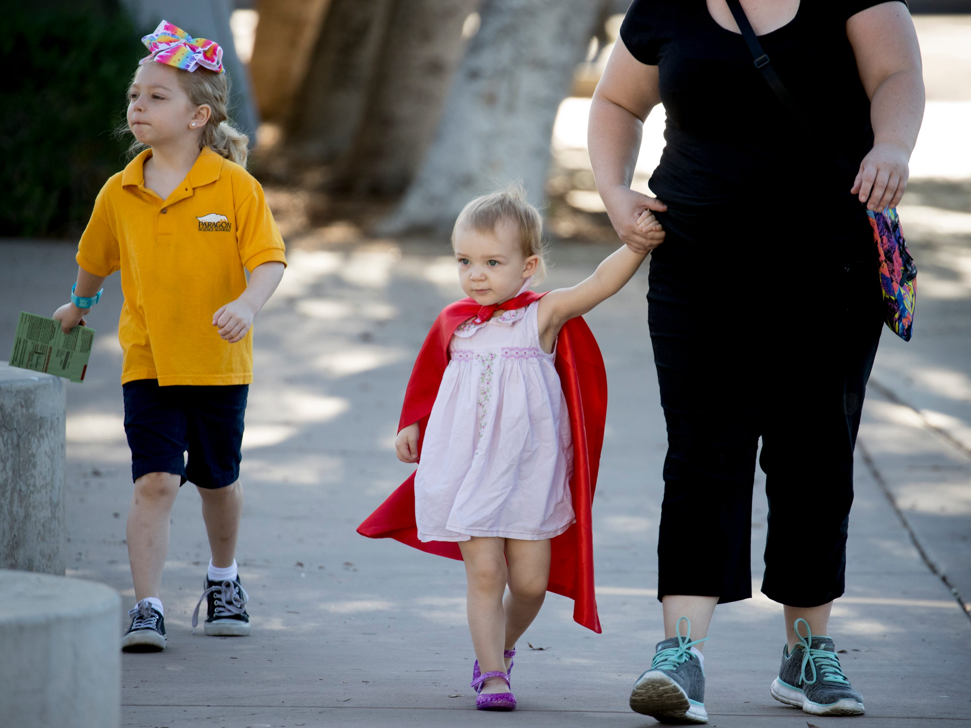 Adina Anhalt (right) and her daughters, Abigail (left, 7) and Evelyn (center, 2) arrive to drop off her ballot, Aug. 28, 2018, at the Escalante Community Center polling place, 2150 E. Orange Street in Tempe.